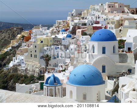 Greek Islands Style White and Blue Colored Churches at Oia Village, Santorini Island of Greece