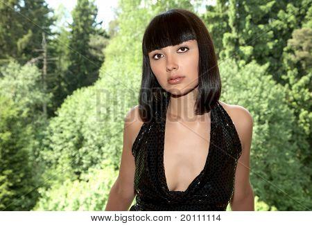 Beautiful Girl Against The Foliage Shined