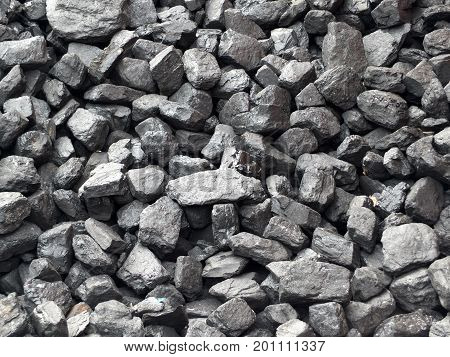 large pieces of black coal industrial background
