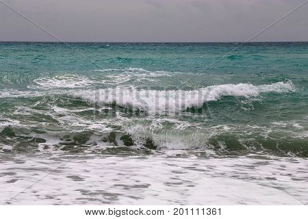 Seascape with big waves in a overcast day