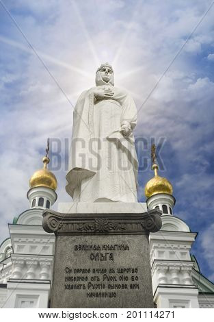 Great princess Olga's monument with Kiev-Pechersk Lavra Church on the background photo. The inscription on the monument is that Russian people believe she will be the first representative of Kyiv Rus to enter the kingdom of heaven.