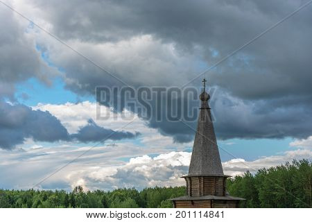 Wooden Church Dome In The Background Of The Cloudy Sky.