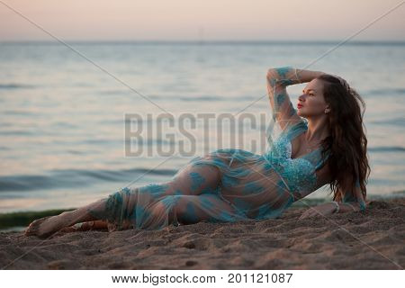 Beautiful sexy woman rest on the sea shore