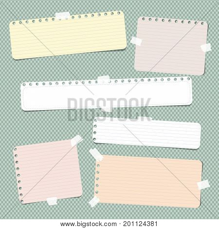 Colorful striped, ruled note, copybook, notebook paper stuck with sticky tape on green background