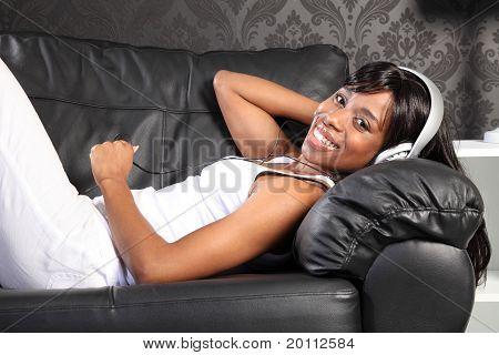 Beautiful Woman At Home Lying Down Enjoying Music