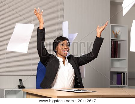Happy Beautiful Business Woman Throws Paper In Air