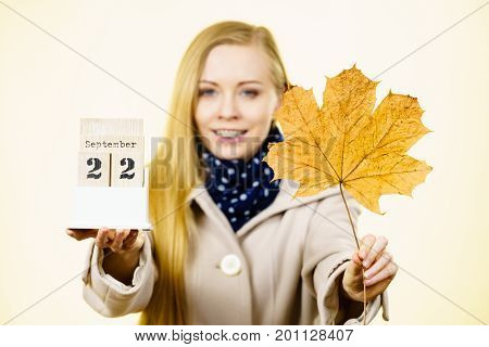 Woman Holding Calendar With First Autumn Day