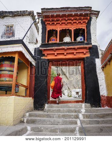 Ladakh India - Apr 1, 2015. A monk coming to ancient Buddhist temple in Ladakh India. Ladakh is the highest plateau in the state of Jammu & Kashmir with much of it being over 3000m.