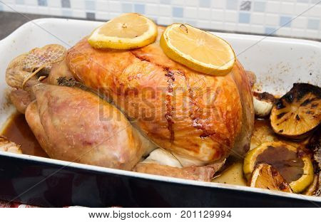 Lemon and garlic chicken Homemade Lemon and garlic Whole Chicken in an oven dish