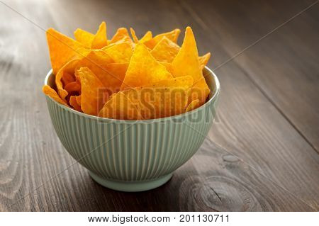Corn Nachos In Blue Bowl On Wooden Background Ready To Eat.