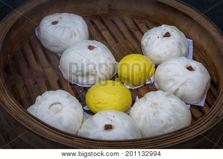 Close up Chinese steam bun on bamboo basket.