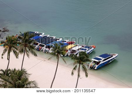 Speed boat by the beach with tourists are doing activities in high season Ang Thong Island Thailand.