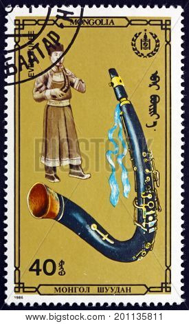 MONGOLIA - CIRCA 1986: a stamp printed in Mongolia shows Ever Buree Mongolian Musical Instrument circa 1986