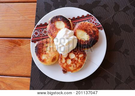 Syrniki - Cottage cheese pancakes, Fritters of cottage cheese - traditional Ukrainian and Russian cuisine
