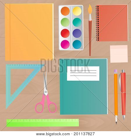 School supplies on a wooden work table top view