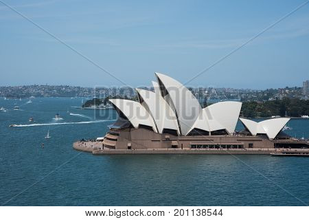 SYDNEY,NSW,AUSTRALIA-NOVEMBER 20,2016: Sydney Opera House with views overlooking nautical vessels and residential development in Sydney, Australia