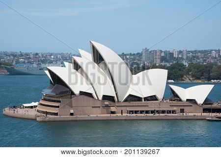 SYDNEY,NSW,AUSTRALIA-NOVEMBER 20,2016: 20th Century architecture at the Sydney Opera House with views overlooking residential areas and naval ship in Sydney, Australia