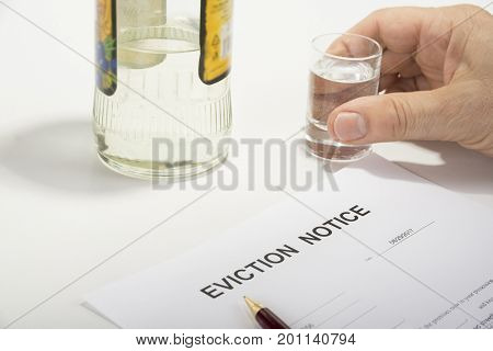 Man drinking spirit because of eviction notice he received