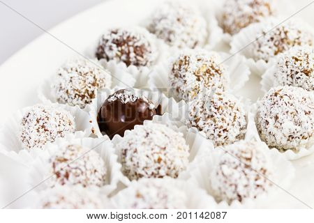 Date and almond pralines in ground coconut