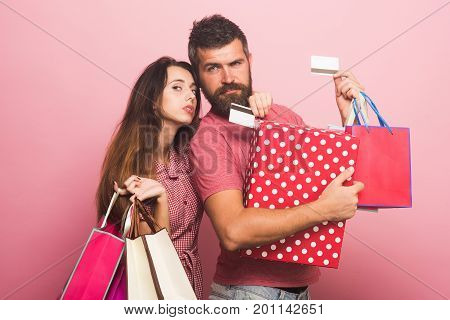 Man With Doubt Holds Credit Cards. Couple In Love