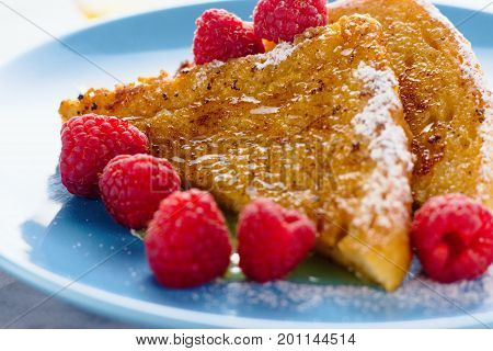 French toast with raspberries sugar and honey