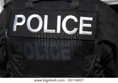 Police   On Swat Officer's Vest.