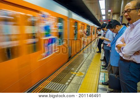 TOKYO, JAPAN - CIRCA MAY 2014: Crowd of people hurry at Ikebukuro station in Tokyo, Japan. Ikebukuru is the second-busiest railway station in the world.