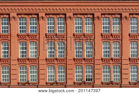 Vintage architecture classical facade building. Front view red brick building.