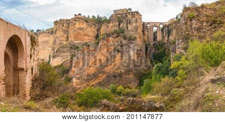 Panorama of Ronda, mountains and Puente Nuevo or New Bridge, over the Tajo Gorge, Andalusia, Spain