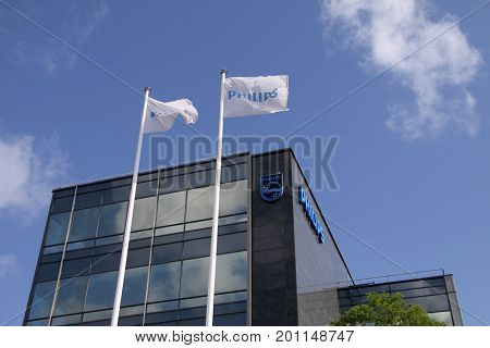 Philips company logo sign on banners. Philips is a Dutch technology company headquartered in Amsterdam with primary divisions focused in the areas of electronics, health care and lighting. Copenhagen, Denmark, August 22, 2017.