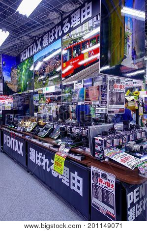 TOKYO, JAPAN JUNE 28 - 2017: Assorted cameras and lenses inside of Yodobashi camera department store. Yodobashi Camera is a chain store mainly selling electronic products with 21 stores in Japan.
