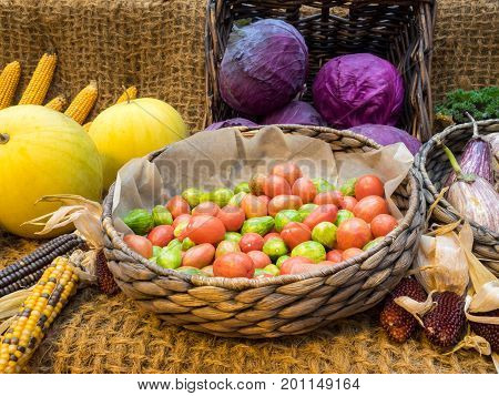 autumn composition with different vegetables in a basket