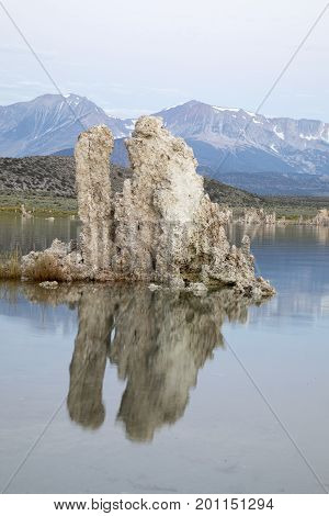 Mono Lake Tufa Rock Formaation Reflecing In Calm Waters