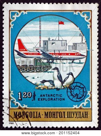 MONGOLIA - CIRCA 1980: a stamp printed in Mongolia shows Penguins and Soviet Plane Antarctic Animals and Exploration circa 1980