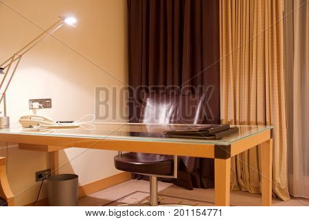 VIENNA, AUSTRIA - APR 28th, 2017: Compact modern office interior in the luxury five stars hotel with a working desk, Hilton Penthouse Suite.