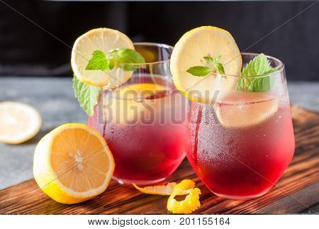Cold Sangria And Ingredients In Glasses