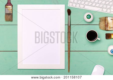 designer painter workspace. Painter workplace top view. Wooden table of an artist with art tools for drawing. painter workspace top view
