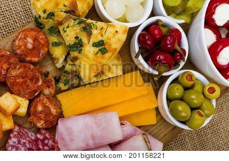 Antipasto Sharing Platter A large wooden sharing platter of Antipasto.