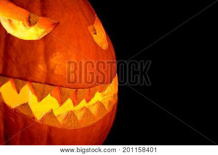 Side view halloween pumpkin smile with fire burning eyes mouth. Big spooky helloween symbol has a glowing mad face and smiling with sharp teeth and bad look. Black orange nightmare of October 31st. poster