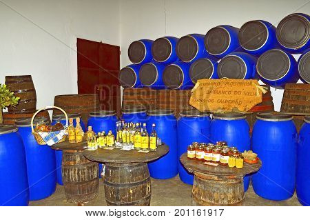 Querenca Algarve Portugal - October 6 2014 : Aguardente Medronho Mourinha is a local brandy made from the fruit of the Strawberry Tree
