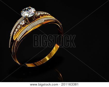 Gold ring with diamond gem jewelry. Luxury jewellery bijouterie with crystal gemstone for people in love . Frontal view and reflection on black background. 3D rendering . Sparkling stones.
