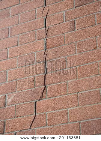 Crack in a brick wall caused by excessive settling due to bad foundations or too much load or earthquake