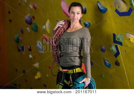 Portrait of happy woman with rope in fitness studio