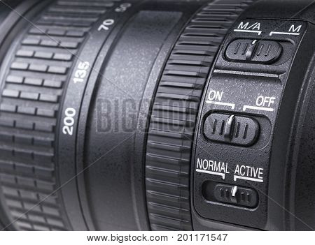 Camera lens with lense reflections. Lens for SLR Single Lens Reflex Camera. Modern digital SLR camera. Detailed photo of a classic wide aperture portrait lens.