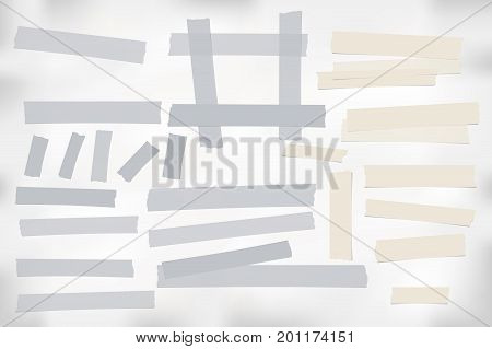 Brown and gray different size adhesive, sticky, scotch tape, paper pieces