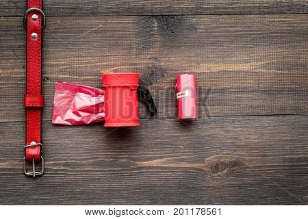 care about pet with red collar and grooming equipment on wooden table background top view mockup