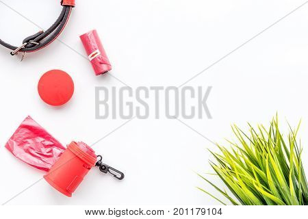 red grooming tools for training pet with collar on white desk background top view mock-up