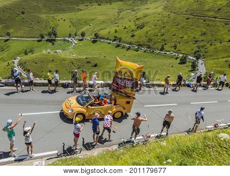 Col de PeyresourdeFrance- July 23 2014: Mc Cain vehicle during the passing of the Publicity Caravan on the road to Col de Peyresourde in Pyrenees Mountains in the stage 17 of Le Tour de France on 23 July 2014.