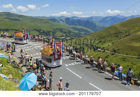 Col de PeyresourdeFrance- July 23 2014: Courtepaille Restaurant vehicles during the passing of the Publicity Caravan on the road to Col de Peyresourde in Pyrenees Mountains in the stage 17 of Le Tour de France on 23 July 2014.