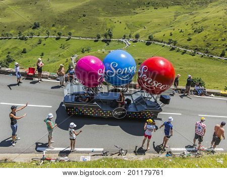 Col de PeyresourdeFrance- July 23 2014: Fancy vehicle of Senseo passing in the Publicity Caravn on the road to Col de Peyresourde in Pyrenees Mountains during the stage 17 of Le Tour de France 2014.
